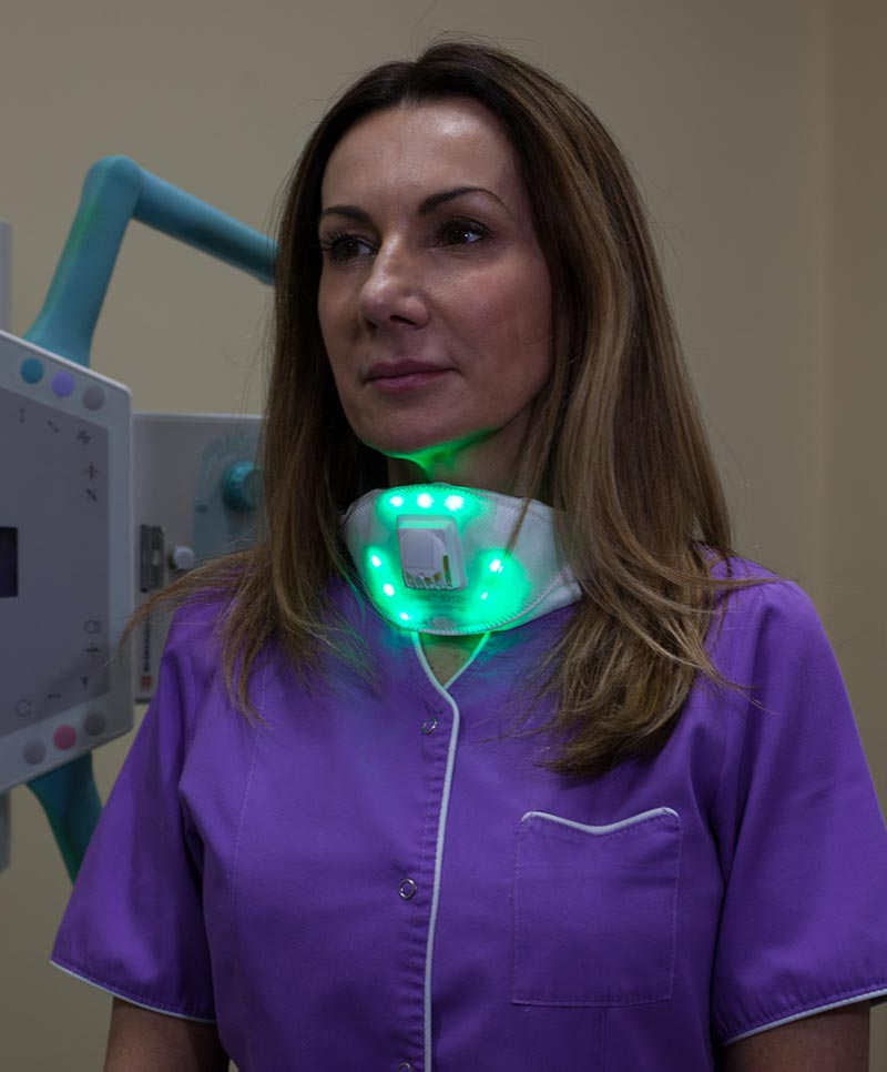 Caption: Radiologist, Dr Katarzyna Przybył wears an LED light mask that change colour according to real time measurements of local air pollution levels. Green means air quality inside the hospital is good, but outside it is a different story.