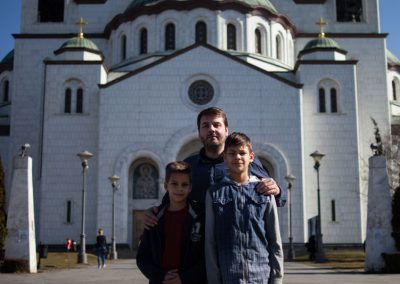 7 Mirko & his sons stand outside the Temple of Saint Sava in Belgrade, Serbia. Global Call for Climate Action / Greg McNevin